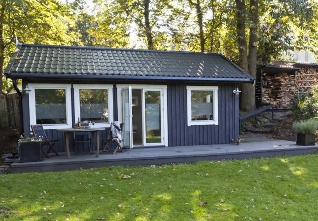 Praktijkruimte huisje van hout for Hout huis
